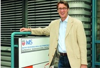 Prof. Dr. Probst in front of the former entrance of the InIIS